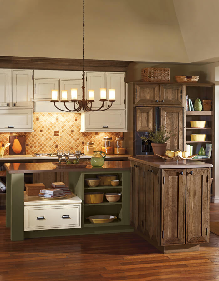 Mix of brown, green and white kitchen cabinets & island