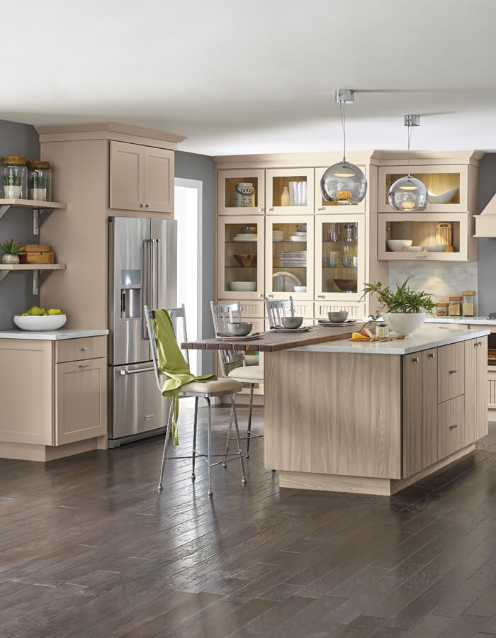 off-white/beige woodgrain cabinets with island and chairs