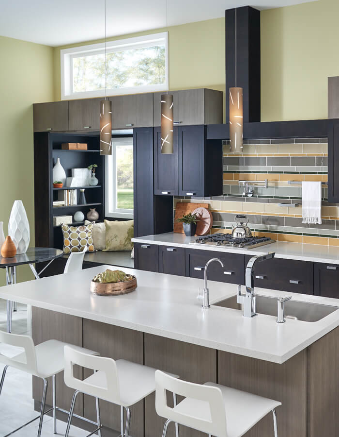 Modern kitchen cabinets in mix of dark colors with sink island and storage