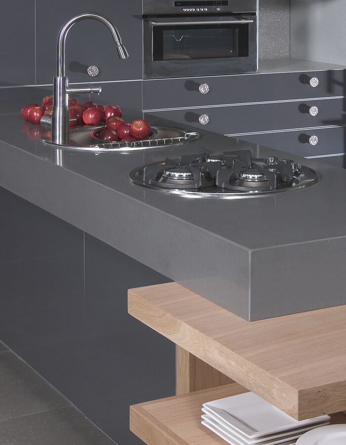 Dark grey countertop with built-in range and sink