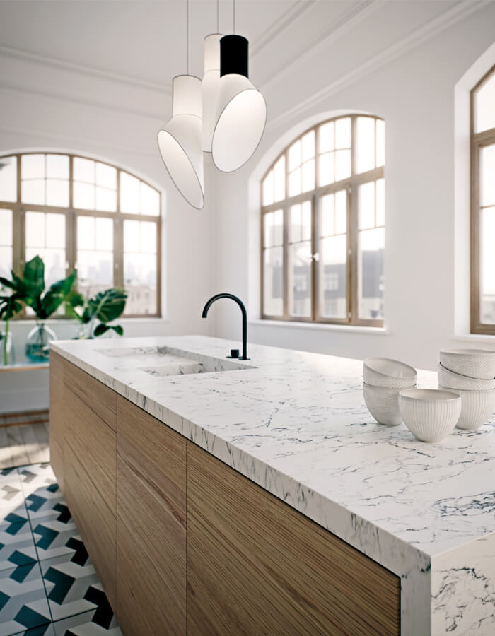White marbled countertop with built-in sink on brown wood grain island