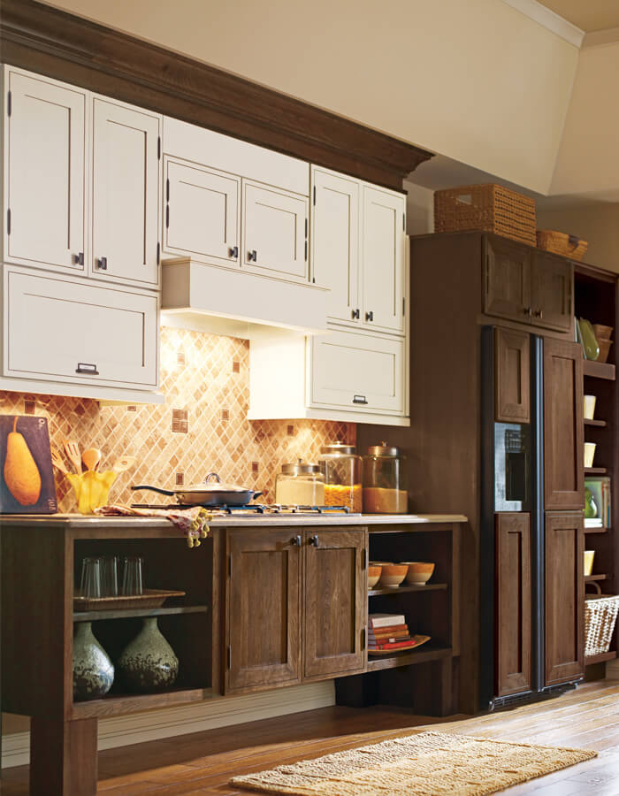Traditional kitchen with mix of dark brown and white cabinets